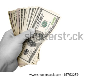 A handful of cash isolated over a white background.  The money has selective color, and the hand is in black and white. - stock photo