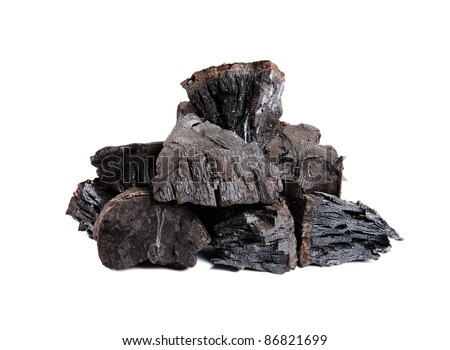 A handful of charcoal. isolated - stock photo