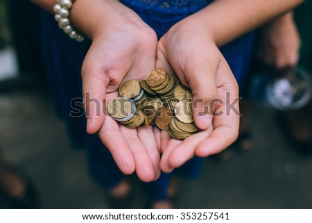 A handful of coins - stock photo