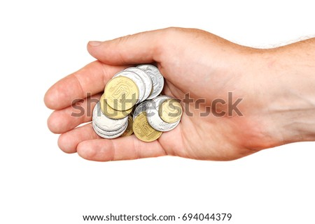 stock-photo-a-handful-of-coins-in-the-pa