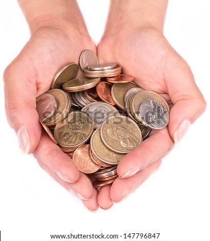 A handful of coins in the palm of hands