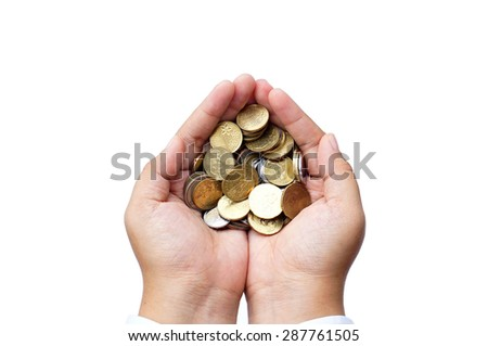 A handful of coins in the palm of hands - stock photo