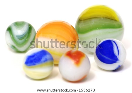 A handful of colorful milky glass toy marbles on a white background