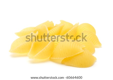A handful of pasta - conchiglle rigate. Closeup. Isolated on white background.