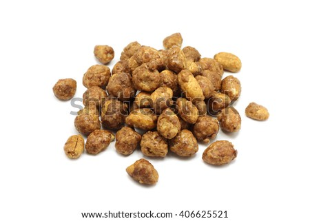 a handful of roasted peanuts in the icing sugar on a white background
