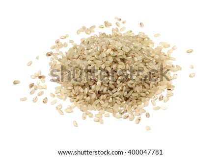 a handful of round red rice on white background - stock photo