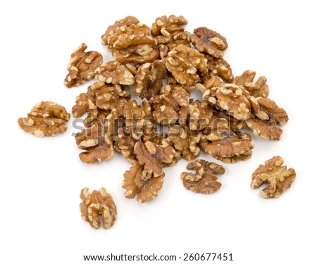 A handful of walnuts isolated on white background