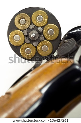 A handgun revolver chamber is open showing ammunition gun ammo personal weapon - stock photo