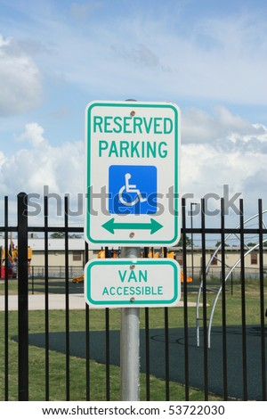 a handicapped parking sign - stock photo