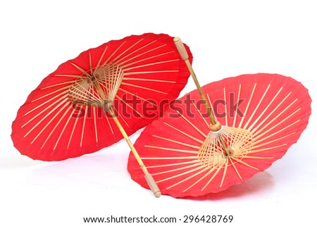 A handmade red, Asian parasol or umbrella isolated