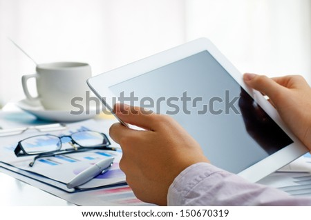 a hands holding a tablet pc - stock photo