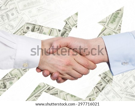 A handshake and arrows made of dollar notes. The concept of successful business. - stock photo