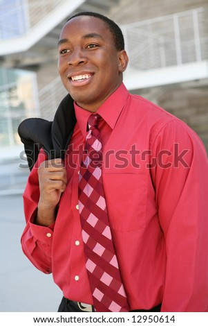 A handsome african american business man at his office building