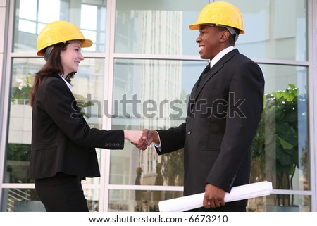 A handsome architect meeting with a client at the worksite - stock photo