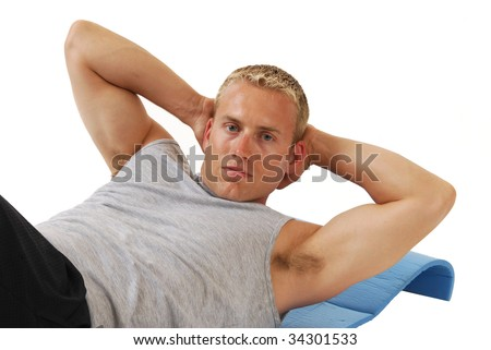 A handsome blond man doing sit ups - stock photo