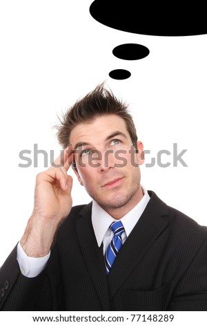 A handsome business man daydreaming while working - stock photo