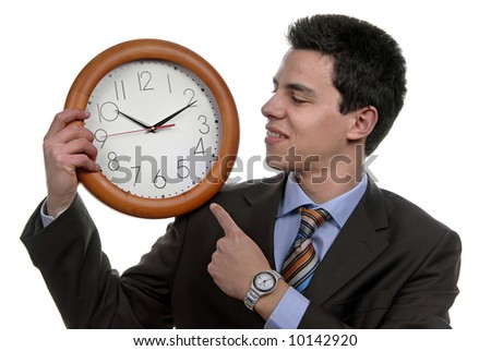 A handsome business man holding a clock
