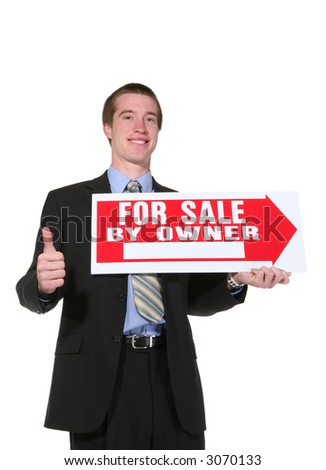 A handsome business man holding a sale sign with his thumbs up