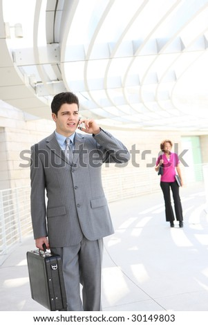 A handsome business man on the phone at office building