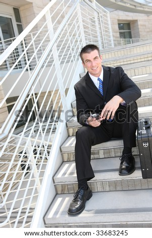A handsome business man on the stairs at company - stock photo
