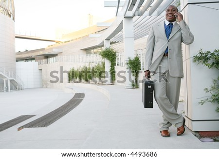 A handsome business man relaxing outside the office - stock photo