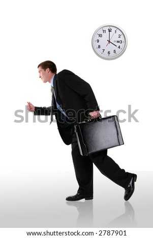 A handsome business man running late for a meeting - stock photo