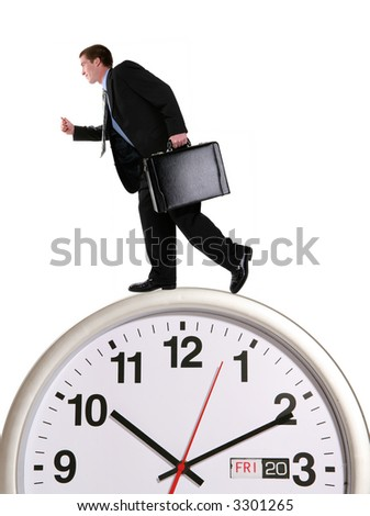 A handsome business man running on a large clock - stock photo