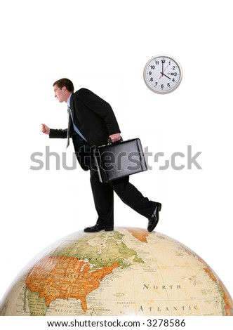 A handsome business man running on a world globe - stock photo