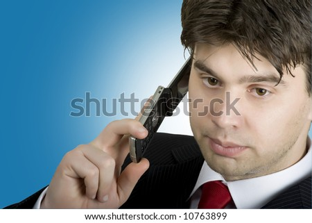 A handsome business man talking on the phone - stock photo