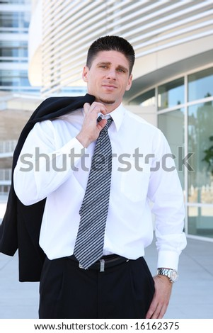 A handsome business outside office building leaving for the day - stock photo