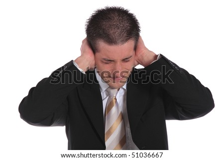 A handsome businessman pressing his hands on his ears. All on white background. - stock photo