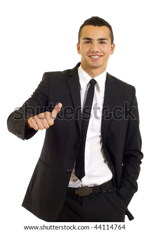 A handsome businessman with thumbs up on an isolated white background - stock photo