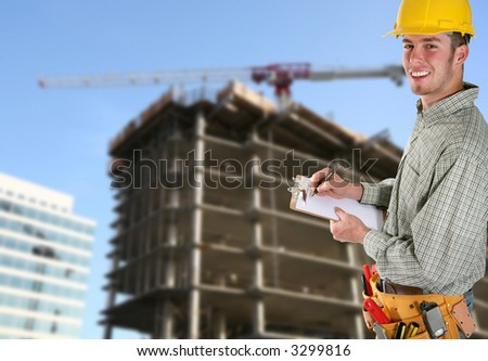 A handsome contruction worker taking notes on a work site - stock photo