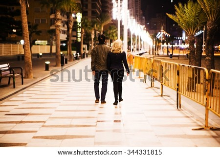 A handsome couple on a date night walk in the city.  - stock photo