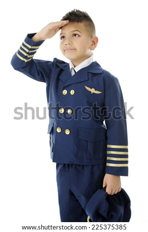 "A handsome elementary ""airline pilot"" saluting with his hat to his side and right hand at his forehead.  On a white background. - stock photo"