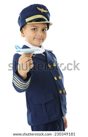 "A handsome elementary ""pilot"" happily moving = a miniature commercial airplane through the air.  On a white background."