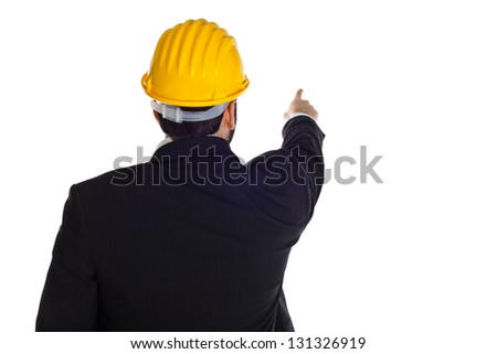 A handsome engineer pointing on white background
