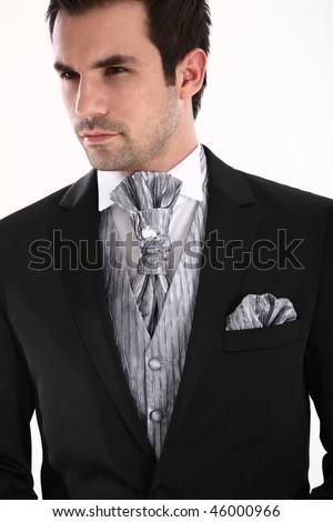 A handsome groom in full tuxedo - stock photo