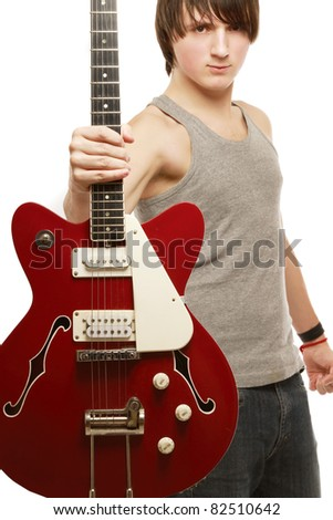 A handsome guitar player, isolated on white - stock photo