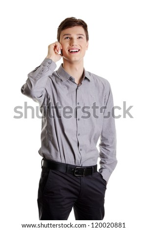 A handsome happy business man using mobile phone, isolated on white - stock photo