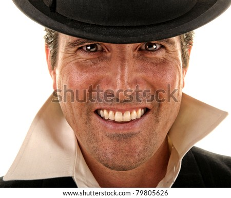 A handsome, happy man wearing a bowlers hat. - stock photo