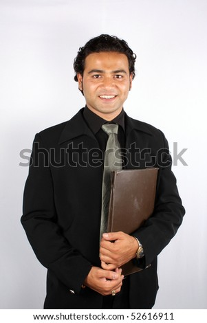 A handsome Indian businessman with a brown file / folder.