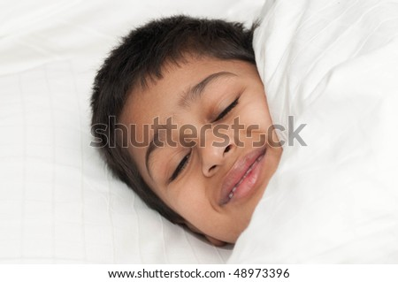 A handsome indian kid smiling for you - stock photo