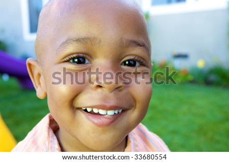 A Handsome little African American Boy smiling for the camera - stock photo