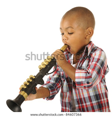 A handsome little boy, mouth opened wide, ready to blow on his toy clarinet.  Isolated on white.