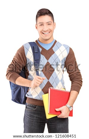 A handsome male student school bag holding books isolated against white background - stock photo