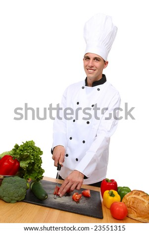 A handsome man chef in the kitchen preparing food - stock photo