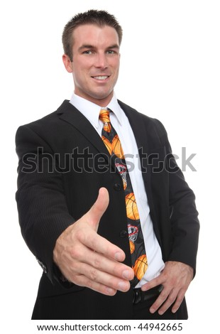 A handsome man coach with a basketball sport tie offering handshake - stock photo