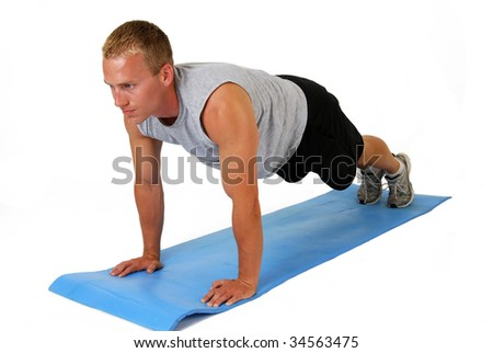 A handsome man doing push ups - stock photo