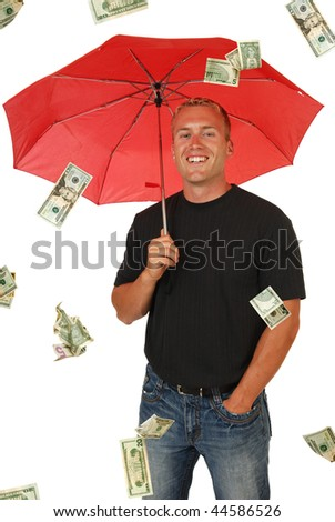 A handsome man in a rainstorm of money - stock photo